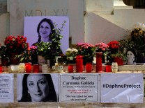 Posters referring to the Daphne Project are seen on the makeshift memorial to assassinated anti-corruption journalist Daphne Caruana Galizia on the Great Siege Monument in Valletta