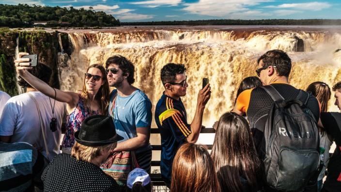 Selfie takers at the Garganta del Diablo Devil s Throat Iguazu Falls UNESCO World Heritage Site
