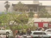 The site of suicide attack on Libyan electoral commission is seen in Tripoli