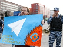 MOSCOW RUSSIA APRIL 30 2018 A man holds a poster as he takes part in a rally for free Internet