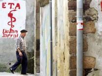 FILE PHOTO: An old man walks past graffiti depicting the logo of Basque separatist group ETA in Goizueta