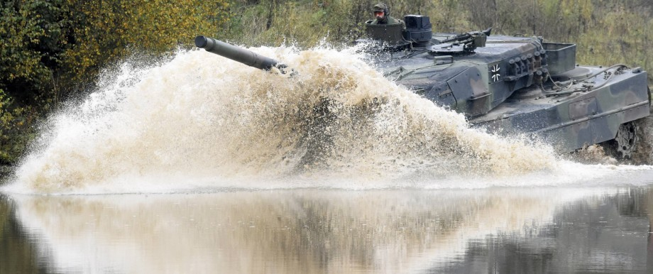 A Leopard 2 tank crosses a river during a German army, the Bundeswehr, training and information day in Munster