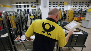 File photo of a postman of Deutsche Post sorting mail at a sorting office in Berlin