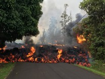 A lava flow moves on Makamae Street in Leilani Estates on the Island of Hawaii often called the Big