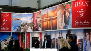 Visitors browse exhibition stand of Iran at the International Tourism Trade Fair in Berlin