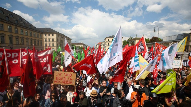 People attend a demonstration to protest against the Bavarian new law on police duty in Munich