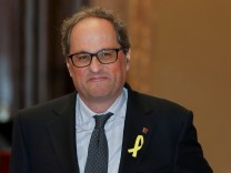 Candidate for head of Catalan regional government Quim Torra arrives to the parliament in Barcelona