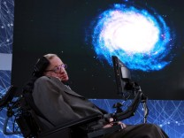 FILE PHOTO: Physicist Stephen Hawking sits on stage during an announcement of the Breakthrough Starshot initiative with investor Yuri Milner in New York
