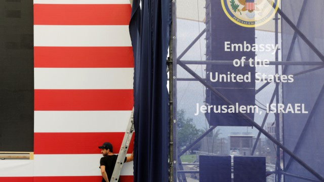 A worker is seen inside the new U.S. embassy compound during preparations for its opening ceremony, in Jerusalem
