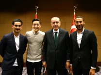 Turkish President Erdogan meets with Premier League soccer players Gundogan of Manchester City, Ozil of Arsenal and Tosun of Everton in London