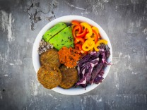 Quinoa Buddha Bowl with paprika avocado red cabbage quinoa quinoa patty ajvar and black sesame