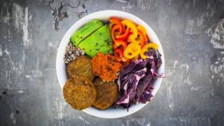 Quinoa Buddha Bowl with paprika avocado red cabbage quinoa quinoa patty ajvar and black sesame
