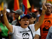 A woman shouts during a protest against upcoming presidential elections, in Caracas