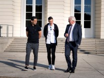German President Steinmeier talks to national team players Gundogan and Ozil during a meeting at Bellevue Castle in Berlin