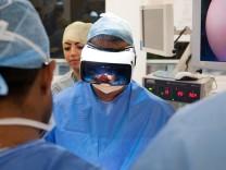 Professor Shafi Amed wearing a VR One headset