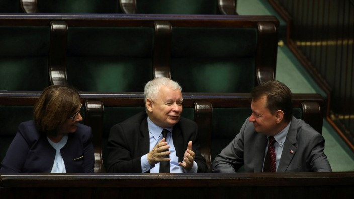 Jaroslaw Kaczynski, the leader of the ruling Law and Justice Party (PiS) attends the parliementary session flanked by the Interior Minister Blaszczak and a PM Mazurek in Warsaw