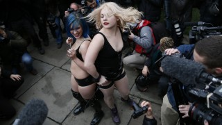 Protesters take part in a demonstration against new laws on pornography outside parliament in central London