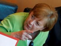 German Chancellor Angela Merkel gestures during weekly cabinet meeting in Berlin
