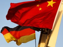 German and Chinese national flags fly in Tiananmen Square ahead of the visit of German Chancellor Angela Merkel in Beijing