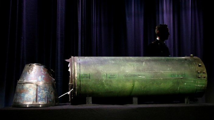 A damaged missile is displayed during a news conference by members of the Joint Investigation Team in Bunnik