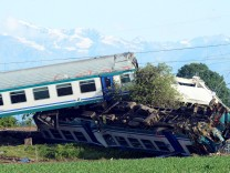 The twisted wreckage of a train that plowed into a truck last night is seen in Caluso