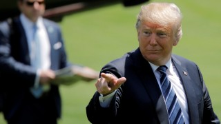 U.S. President Donald Trump gesticulates as he returns from a trip to trip to Annapolis, Maryland, in Washington, U.S.