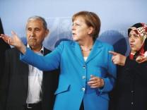 German Chancellor Angela Merkel meets with Durmus and Mevluede Genc in Dusseldor