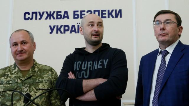 Russian journalist Babchenko, who was reported murdered in the Ukrainian capital, Ukrainian Prosecutor General Lutsenko and SBU chief Gritsak attend a news briefing in Kiev