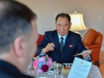 North Korean envoy Kim Yong Chol and U.S. Secretary of State Mike Pompeo exchange signatures on the menu during a working dinner in New York