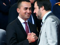 Italy's Minister of Labor and Industry Luigi Di Maio shakes hands with Interior Minister Matteo Salvini at the Republic Day military parade in Rome