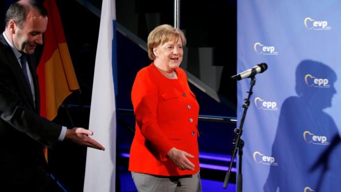 German Chancellor Angela Merkel (CSU) arrives with Manfred Weber at the EPP meeting in Munich