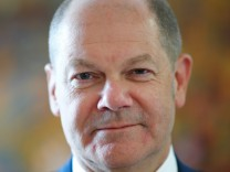German Finance Minister Olaf Scholz poses for a portrait before a Reuters interview in Berlin