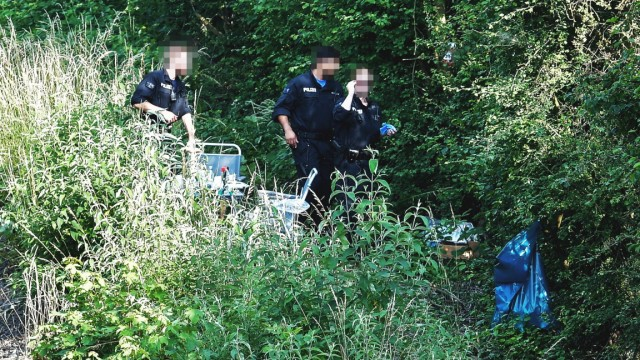 German police stand at the area where they found a body near Wiesbaden-Erbenheim
