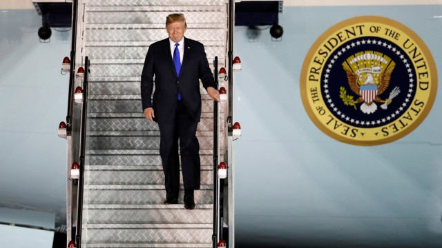 U.S. President Donald Trump steps off his plane as he arrives at Paya Lebar Air Base in Singapore