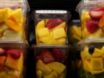 Cut fruit for sale are pictured inside a Whole Foods Market in the Manhattan borough of New York City