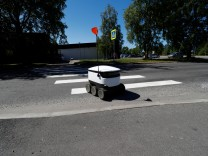 Estonian company's Starship local delivery robot crosses a street in Saue