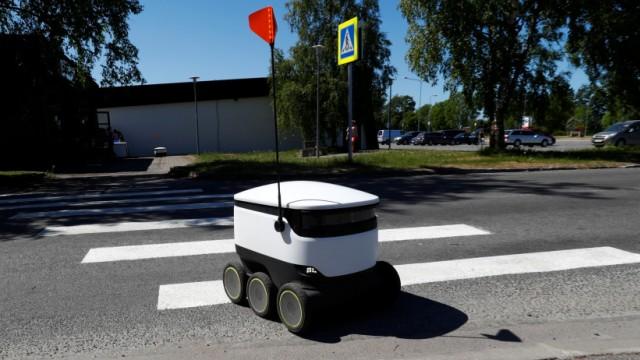 Estonian company's Starship local delivery robot crosses a street in Saue