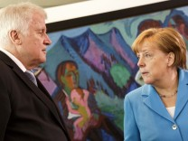 FILE PHOTO: German Chancellor and CDU head Angela Merkel and Interior Minister and sister party CSU head Horst Seehofer are locked in a fight over asylum/migration