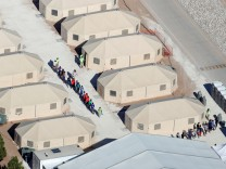 Immigrant children, many of whom have been separated from their parents under a new 'zero tolerance' policy by the Trump administration, are being housed in tents next two the Mexican border in Tornillo, Texas