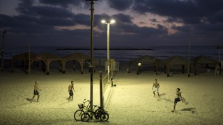 Footvolley at the beach in the evening