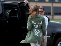 U.S. first lady Melania Trump arrives back in Washington from Texas wearing 'I Don't Care. Do U?' jacket at Joint Base Andrews, Maryland