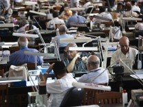Diamond dealers work on the trading floor of Israel's diamond exchange in Ramat Gan near Tel Aviv