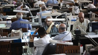 Diamond dealers work on the trading floor of Israel's diamond exchange in Ramat Gan near Tel Aviv