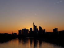FILE PHOTO: The skyline with its characteristic banking towers is pictured during sun down after a sunny spring day in Frankfurt