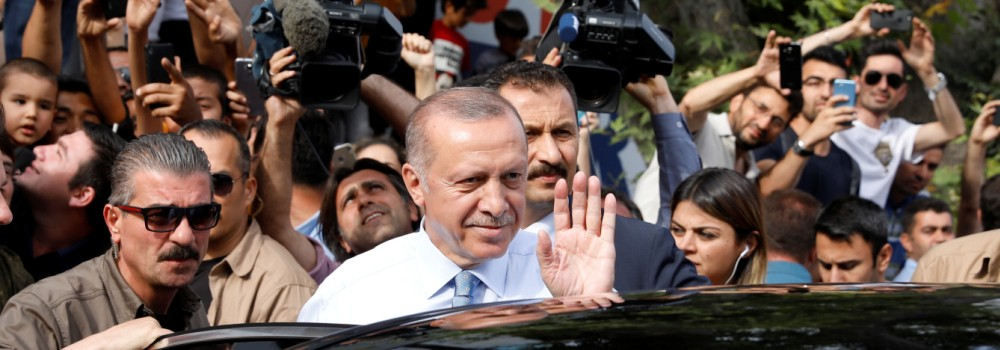 Turkish President Tayyip Erdogan waves to supporters as he leaves his residence in Istanbul