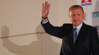 Turkish President Tayyip Erdogan greets his supporters gathered in front of the AKP headquarters in Ankara
