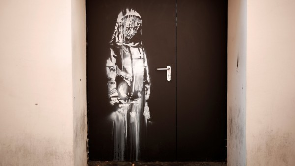 A recent artwork believed to be attributed to British activist-artist Banksy is pictured in Paris; jetzt Banksy