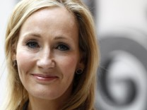 File photograph shows British writer JK Rowling, author of the Harry Potter series of books, posing during the launch of the new online website Pottermore in London; jetzt JKR