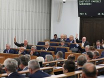 Members of the Senate hold a debate on the Holocaust bill in Warsaw