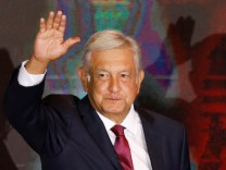 Presidential candidate Andres Manuel Lopez Obrador waves as he addresses supporters after polls closed in the presidential election, in Mexico City